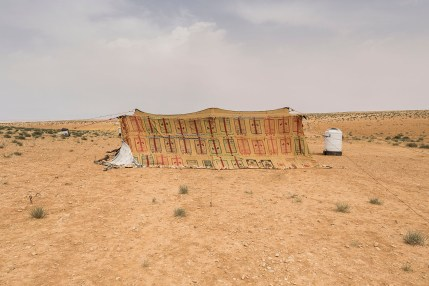 A tent in an impromptu camp at the outskirts of Azraq. Most families have pitched tents they took when they left Zaatari but some hadn't been to the refugee camp and had to scrape whatever materials were available to build shelter.