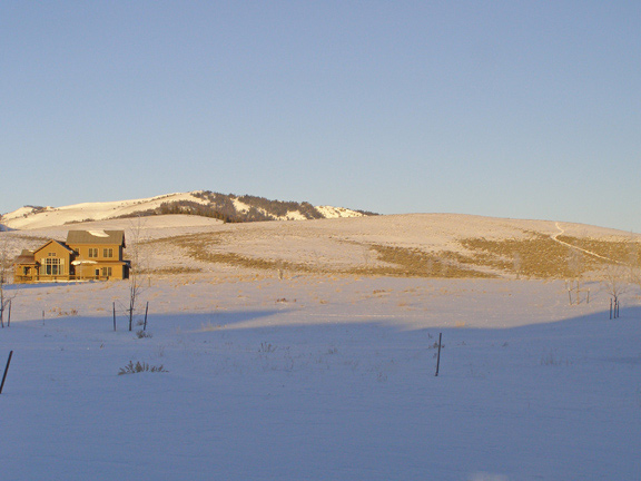 Stacey's view of the wide open spaces in Granby, circled by hills and mountains.