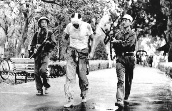 Prisoner being escorted to Hanoi Hilton