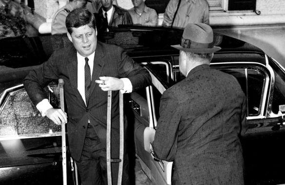 Injured JFK leaves vehicle