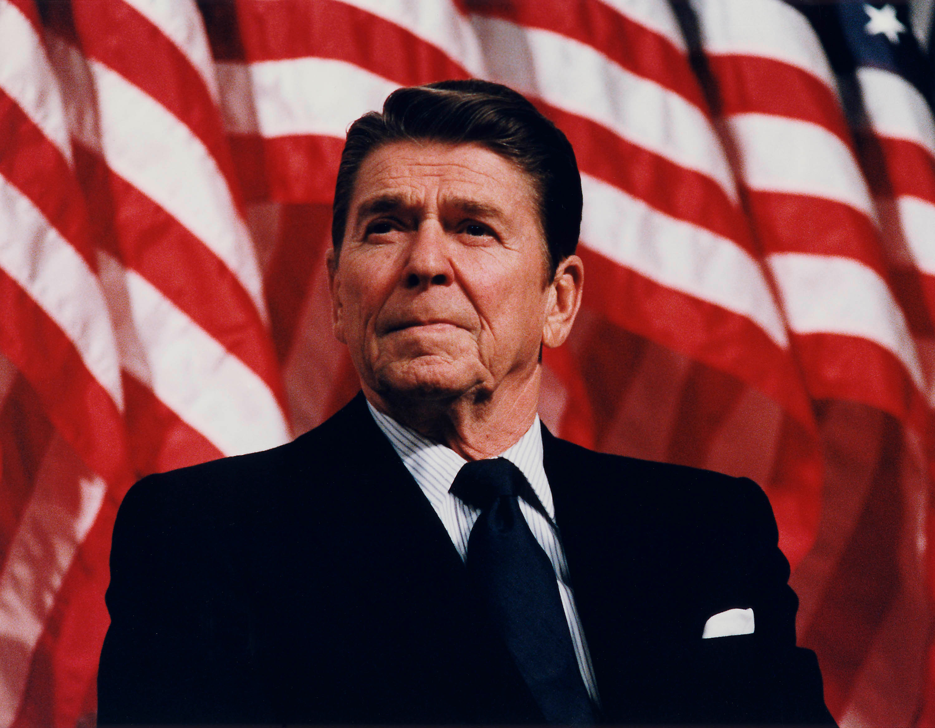 President Reagan in front of a flag