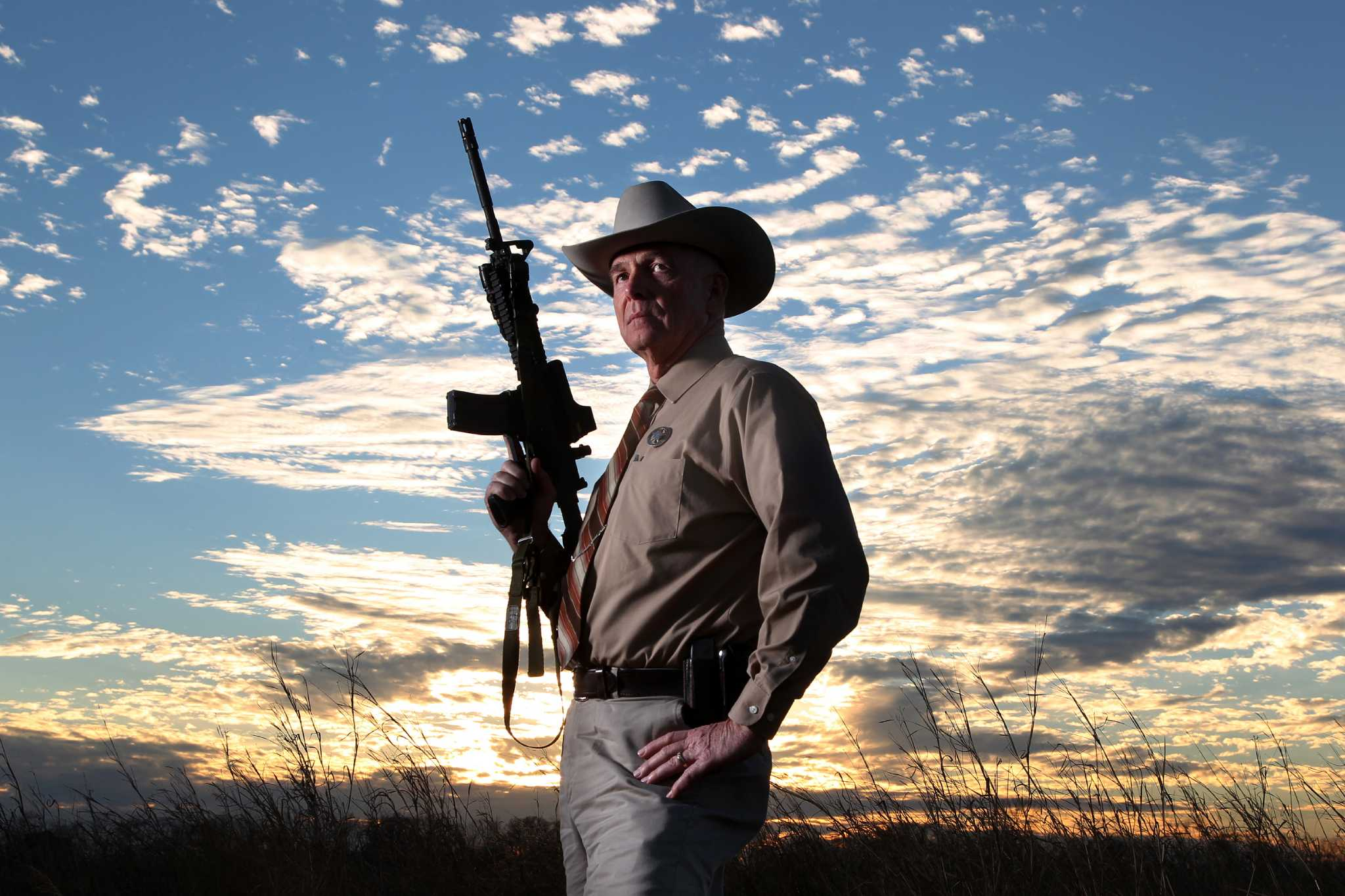 A Texas Ranger holding an assault rifle