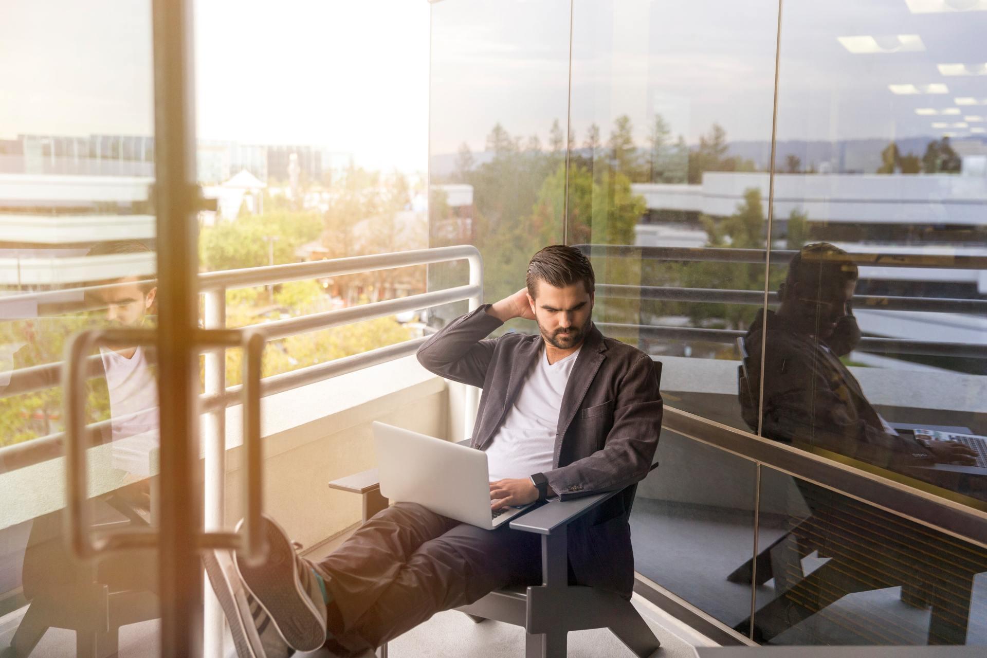 Man sits outside pondering work