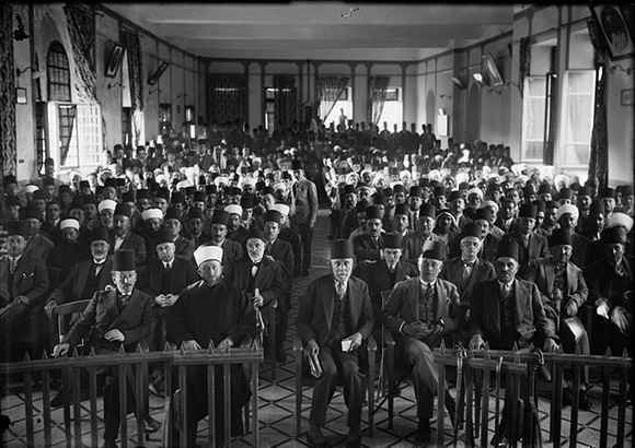 A Palestinian protest gathering in session in the Rawdat el Maaref hall, following the 1929 violence.