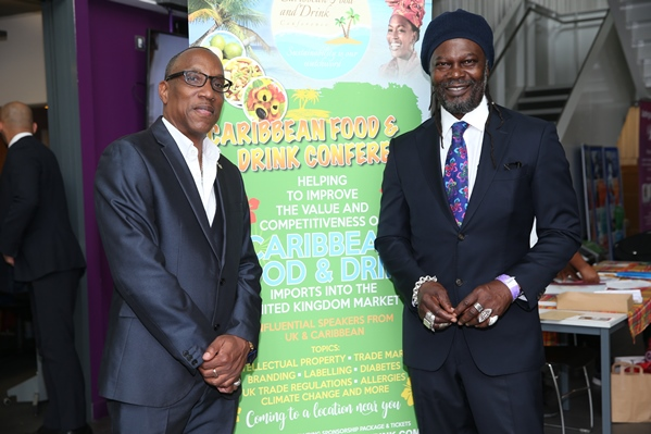 Posing with Celebrity cehef and TV presenter Levi Roots at the Caribbean Food and Drink Conference 2017. Photo courtesy CaribDirect