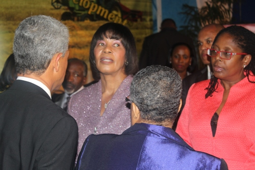 Prime Minister The Hon. Portia Simpson Miller speaking with JSE Chairman Mr Donovan Perkins