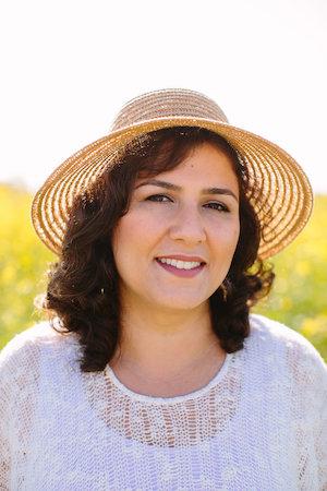 Rosa Daneshvar smiling wearing a hat