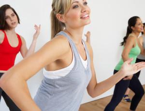 Group Of Women Exercising In Dance Studio