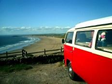 VW Van Vdub overlooking a beach in Wales