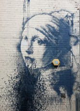 BANKSY Girl with a Pearl Earring by Johannes Vermeer appears in Bristol harbourside October 2014 photo David J Rodger