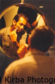 Drummer shaving before a show