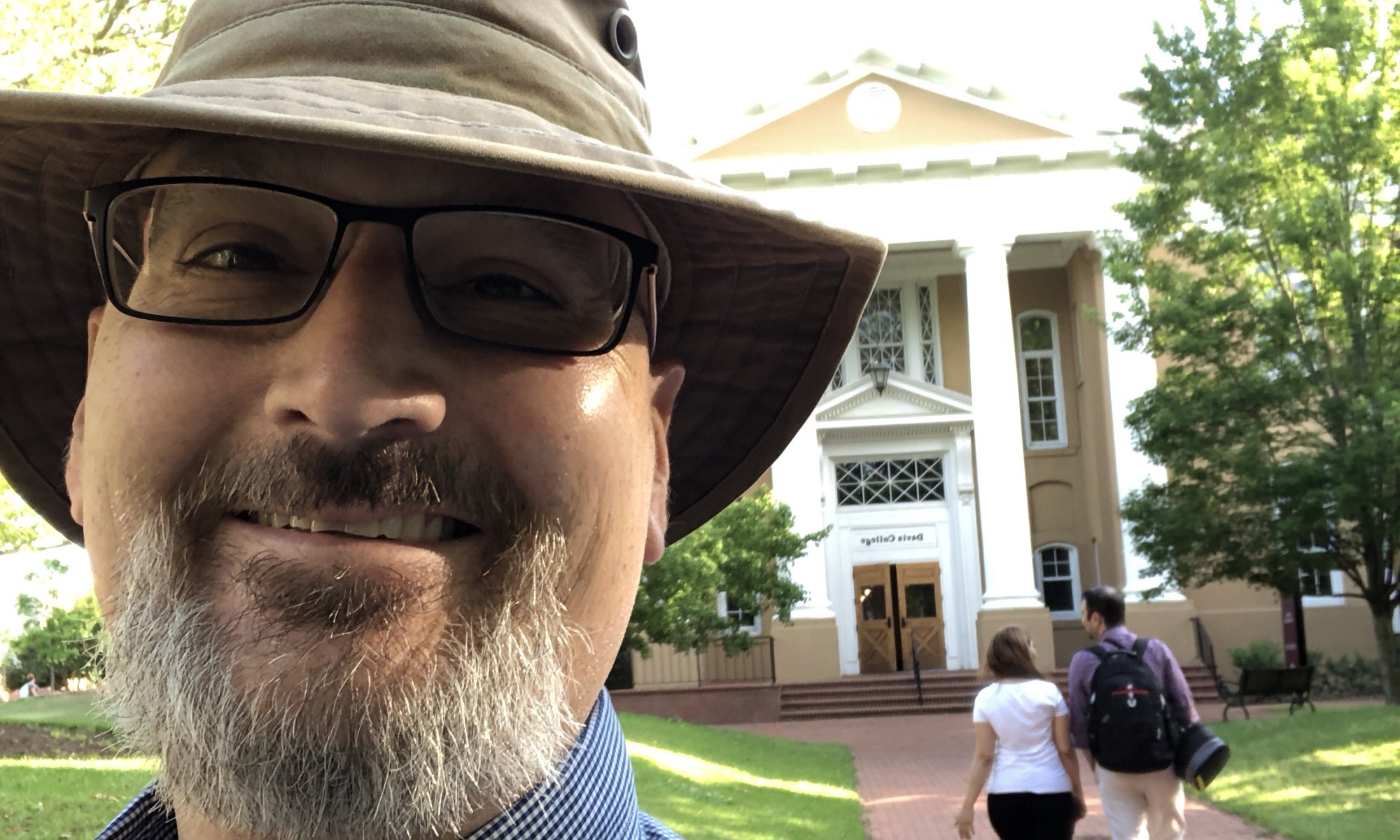 David in front of Davis College