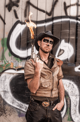 """""""If you're in New Orleans you're probably seeing more of the edgy Clay Mazing, the cowboy who's cracking his whip, and with the flaming shotguns,"""" Clowns Without Borders' Molly Levine says of Clay Mazing. """"It's fun crazy stuff. And when he is doing the Clowns Without Borders shows, he's in character, but as a really child-friendly clown."""" (Photo by Mike Shane)"""