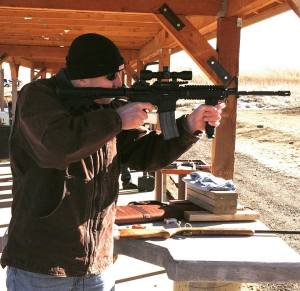 Author David McCaleb shooting AR-15 at Fort Carson, Colorado
