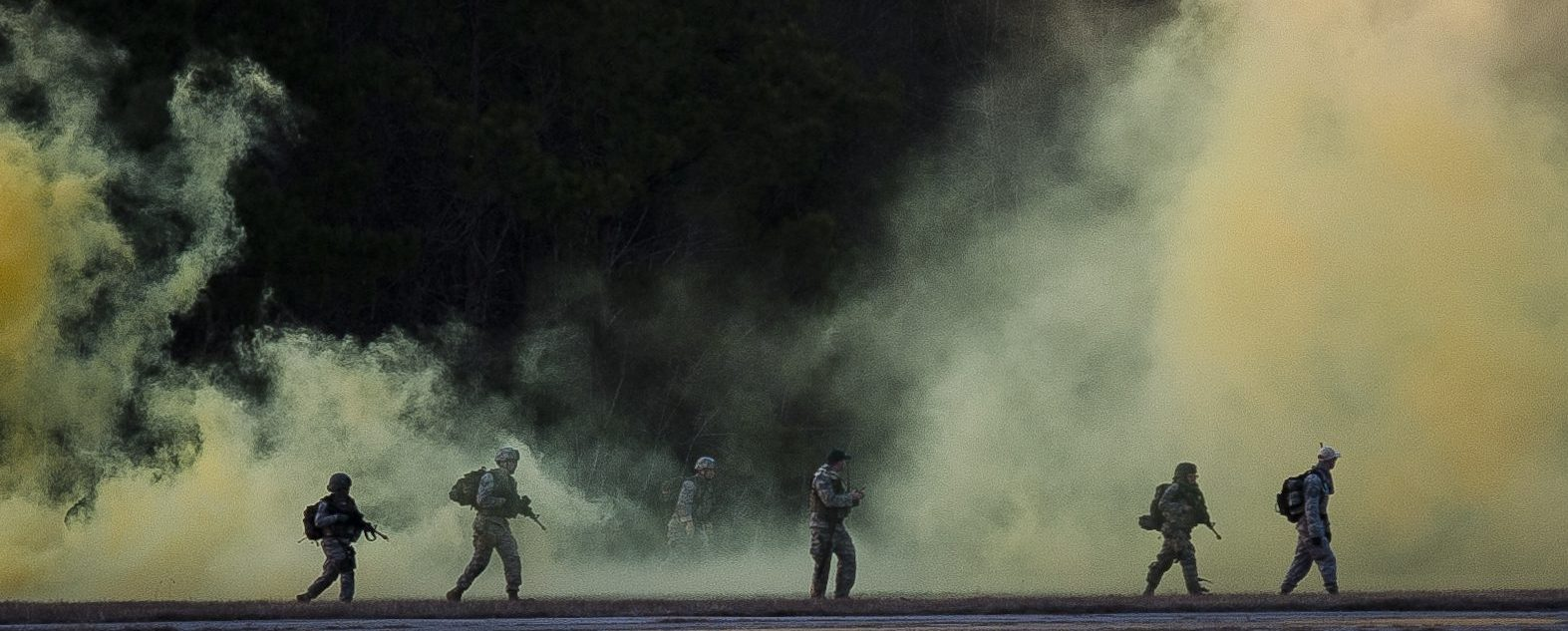 Photo Gallery of author David McCaleb, soldiers walking before smoke screen