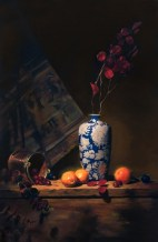 """white and blue vase with oranges 