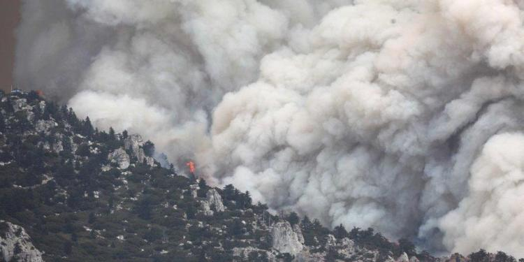 IDYLLWILD, CA - JULY 26: The Cranston Fire burns in San Bernardino National Forest on July 26, 2018 near Idyllwild, California. Fire crews are battling the 4,700-acre fire in the midst of a heat wave. Mario Tama/Getty Images/AFP == FOR NEWSPAPERS, INTERNET, TELCOS & TELEVISION USE ONLY ==