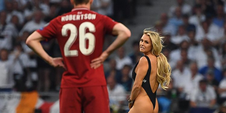 TOPSHOT - Liverpool's Scottish defender Andrew Robertson looks at a pitch-invader running on the pitch during the UEFA Champions League final football match between Liverpool and Tottenham Hotspur at the Wanda Metropolitano Stadium in Madrid on June 1, 2019. (Photo by Paul ELLIS / AFP) (Photo credit should read PAUL ELLIS/AFP/Getty Images)