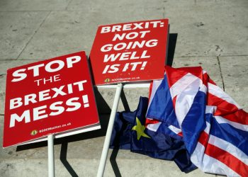 Anti-Brexit placards are seen on the floor outside the Houses of Parliament in London, Britain, May 13, 2019. REUTERS/Hannah McKay