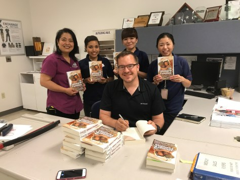 Signing books at the Base Exchange