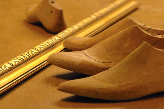 Work tools of shoemaker on wooden surface