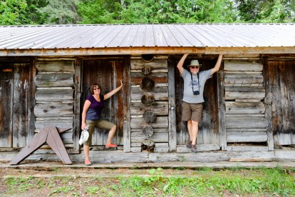 A couple pose near a log cabin on Clearwater River.