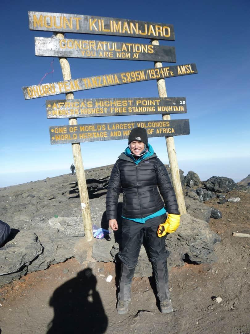 Simone Knego on top of Mount Kilimanjaro