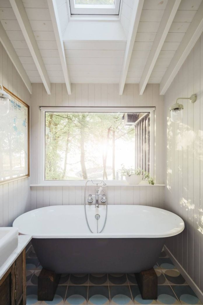 Rustic Bathroom With Skylights