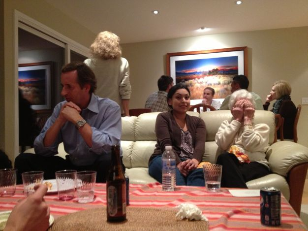 Good to see family and friends sharing conversation and memories. Grandma is playing peek-a-boo with Abby :)