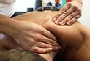therapist working muscles of shoulder blade - medical massage for physicians