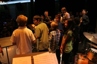 photo of David Sills with students in band practice