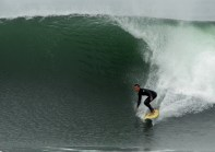 Photo of David Sills - Surfer-Saxophonist riding a wave at El Porto