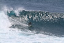 Photo of David Sills - Surfer-Saxophonist riding a wave shooting a tube