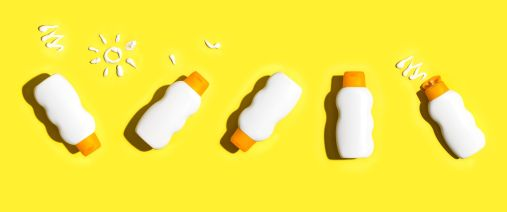 5 bottles of sunscreen with yellow background