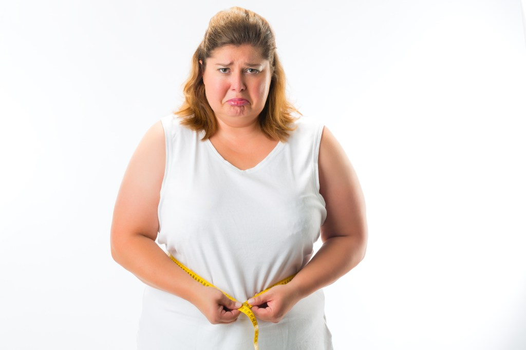 woman disappointed with weight gain