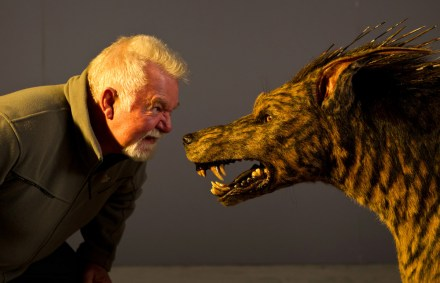 David Eggby exchanging growls with Jackal puppet, Eggby on left, RIDDICK, 2012.