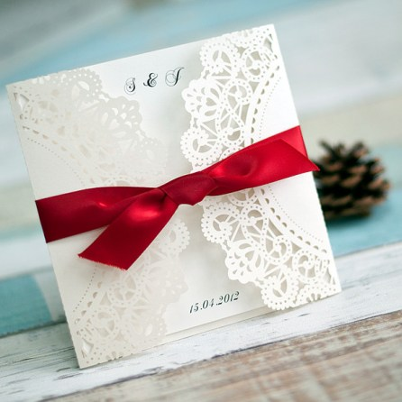 http://www.elegantweddinginvites.com/product/classic-white-laser-cut-wedding-invitations-with-red-ribbon-ewws041/?pin0417