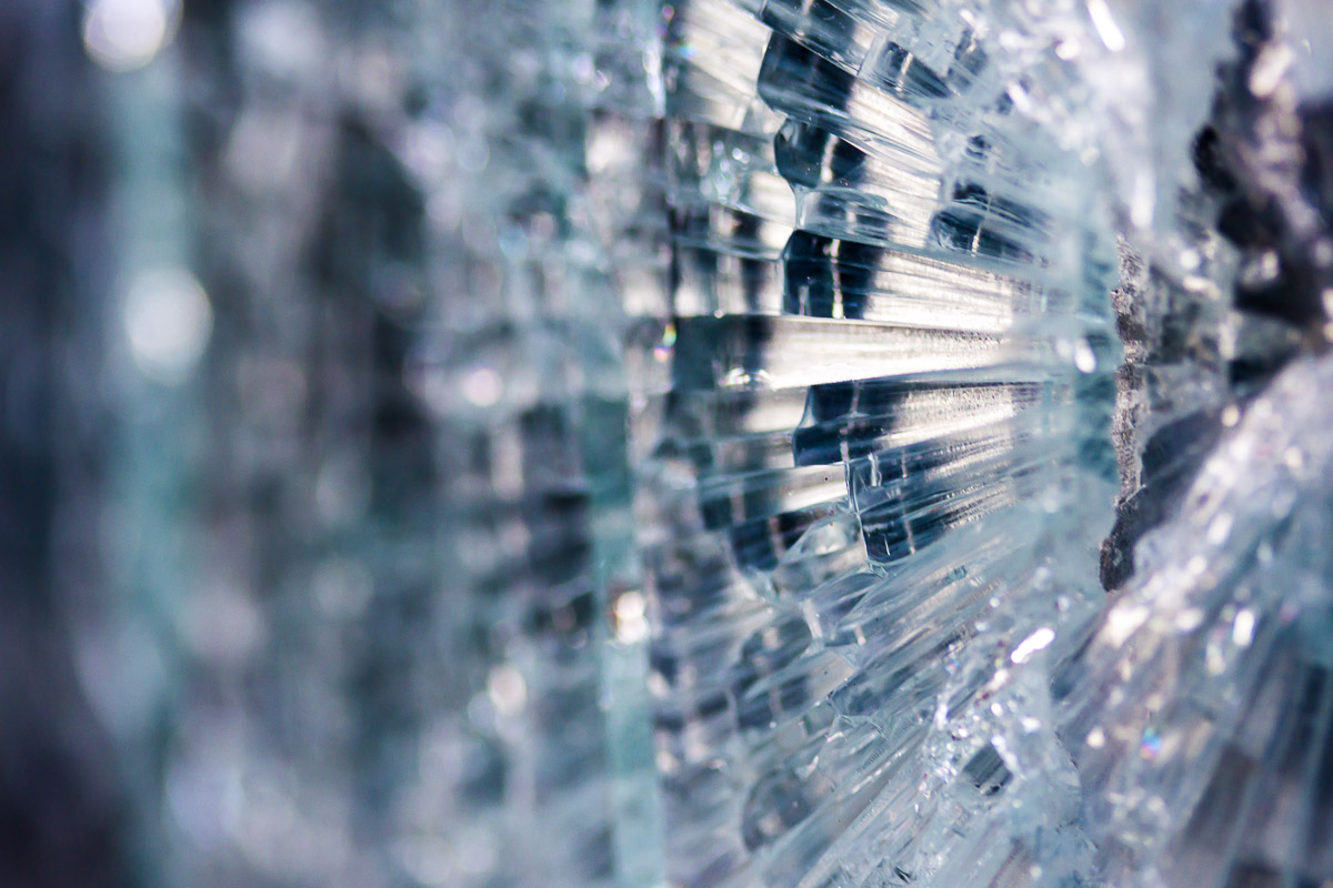 Abstract image of broken glass in various shades of blue and purple