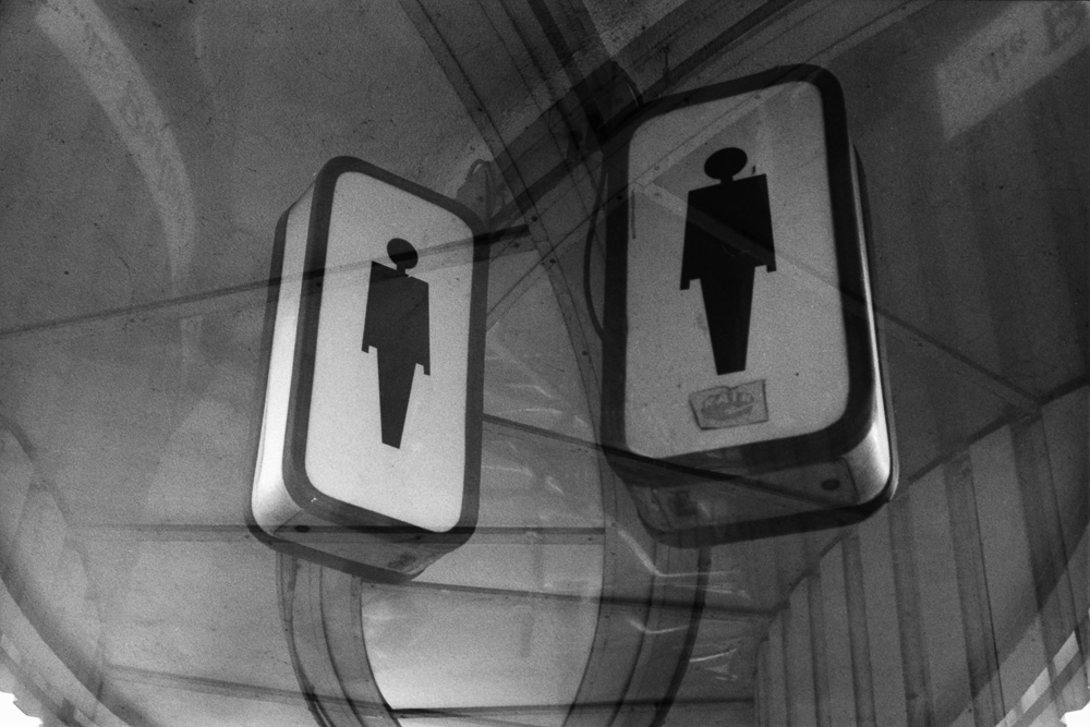 Double exposure of a sign with a male figure