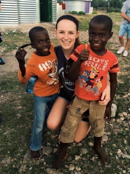 Clarissa in Haiti with 2 boys