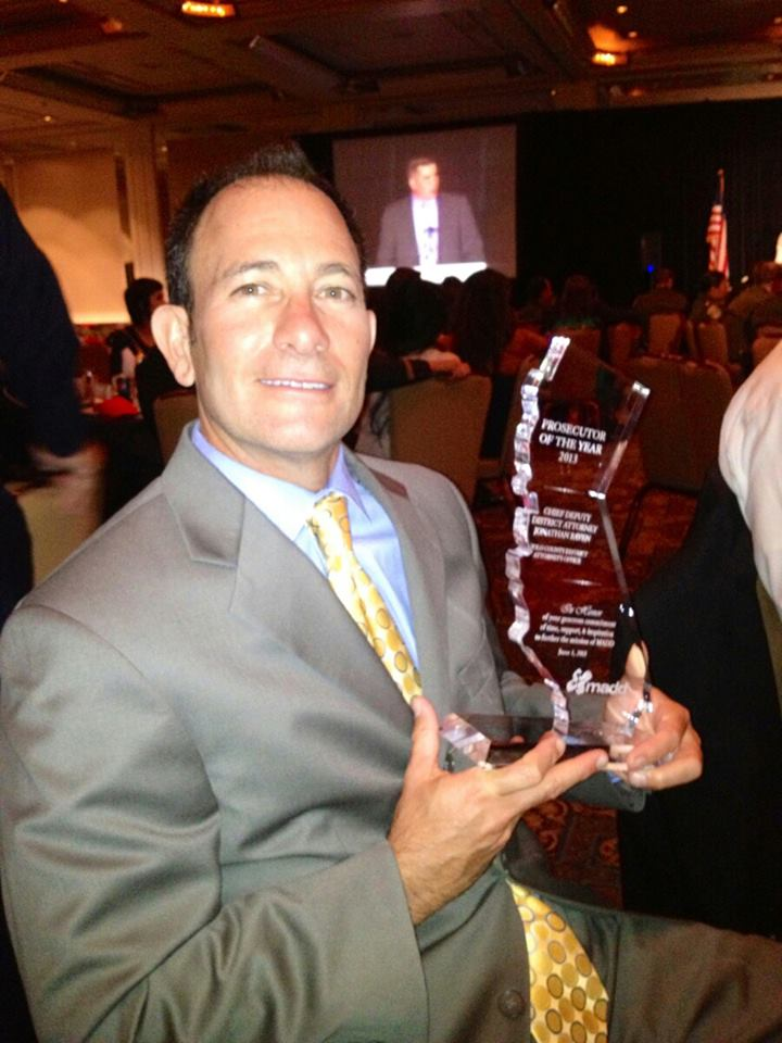 Yolo County Chief Deputy District Attorney Jonathan Raven displays the Prosecutor of the Year  award