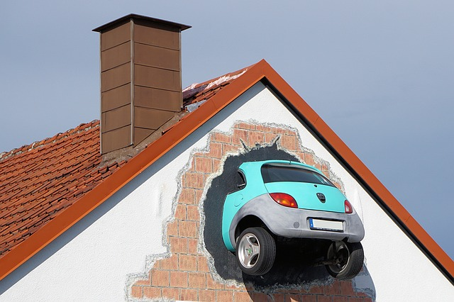 car in the roof of a house