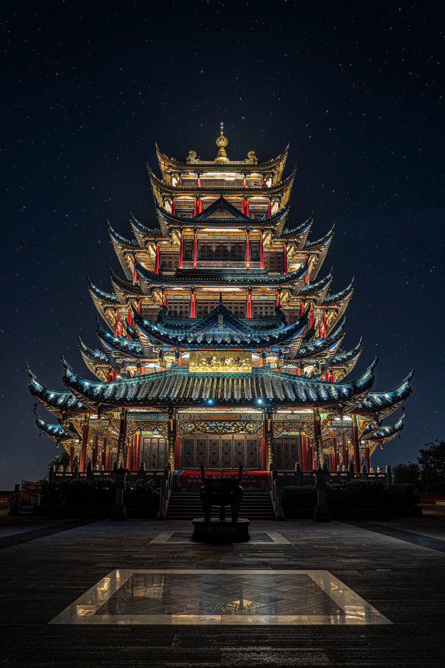 blue yellow and green lighted pagoda tower