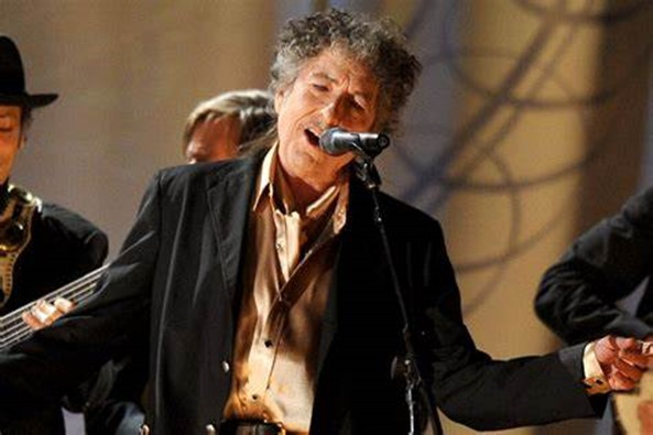 BOB DYLAN CASHES IN