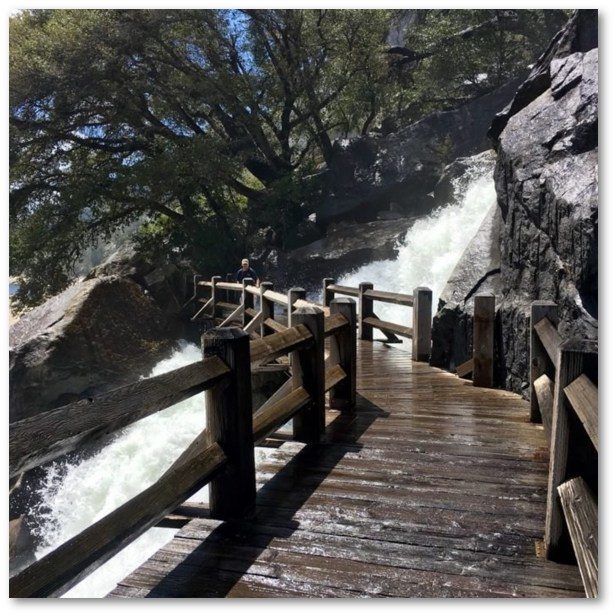 NOR CAL ADVENTURES A TRAIL THAT GOES THROUGH A WATER FALL