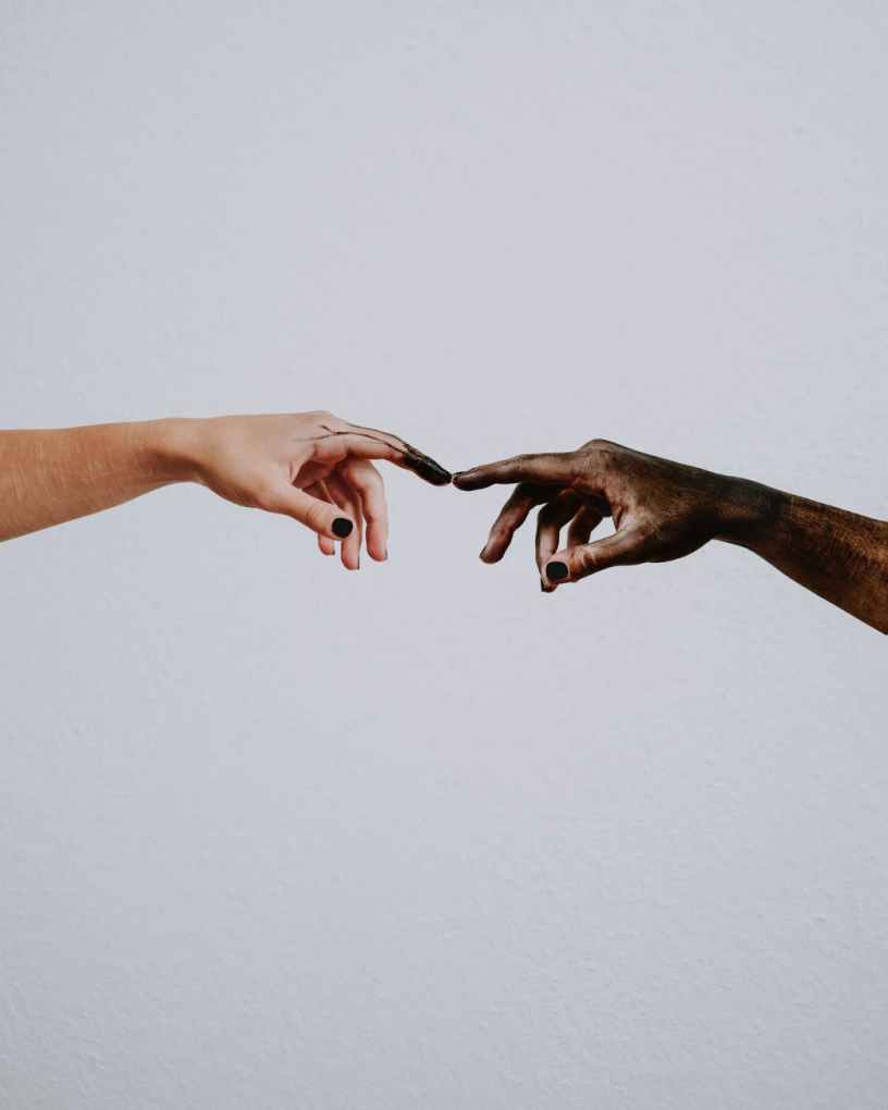 hands of people reaching to each other