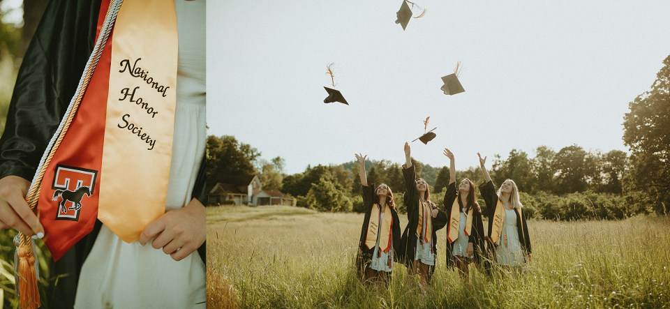 seniors throwing caps in air in a field