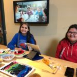 Athabaskan youth sharing beading knowhow