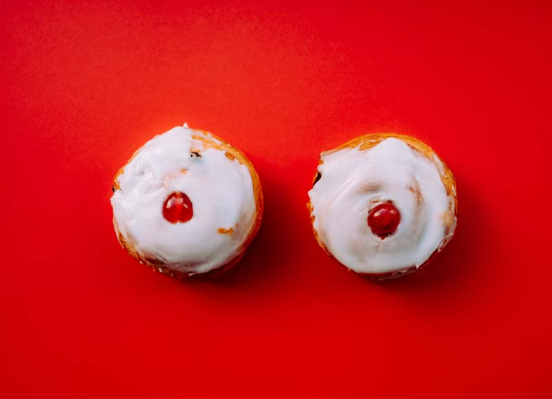 Cupcakes with cherries on them that look like breasts