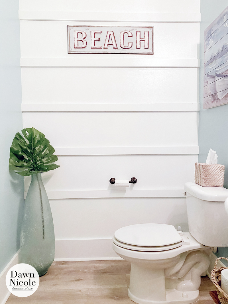 Beachy Little Half Bathroom. Creating a powder room with coastal touches and a board and batten accent wall.
